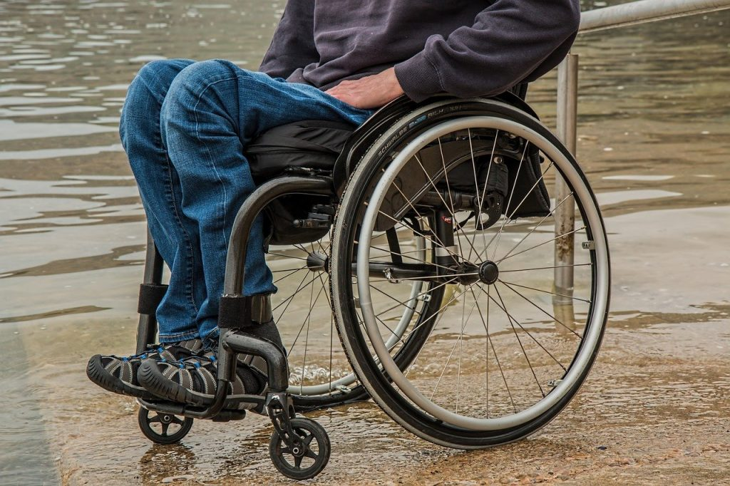 Man in wheelchair with Special Needs Trust
